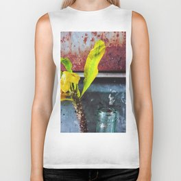 yellow euphorbia milii plant with old lusty metal background Biker Tank