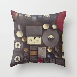 Music. Vintage wall with vinyl records and audio cassettes hung. Throw Pillow