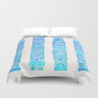tiki Duvet Covers featuring Tiki Totems – Turquoise Palette by Cat Coquillette