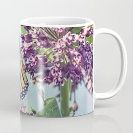 Monarch butterfly perched on pink swamp milkweed flowers Coffee Mug