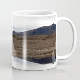 Reflections of the Rolling Hills and Snow-Covered Mountains on the Road to Edoras Coffee Mug