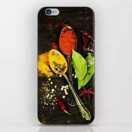 Bright spices on an old  wooden board iPhone Skin