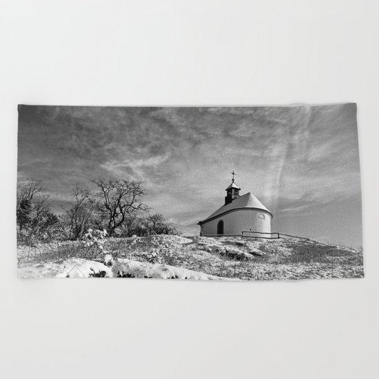 Chapel in the snow Beach Towel