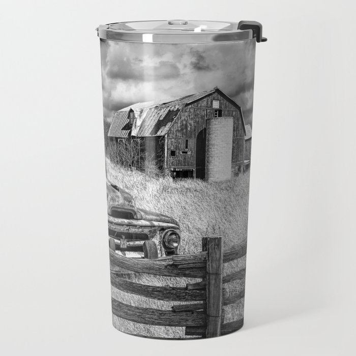 Black and White of Rusted International Harvester Pickup Truck behind wooden fence with Red Barn in Travel Mug