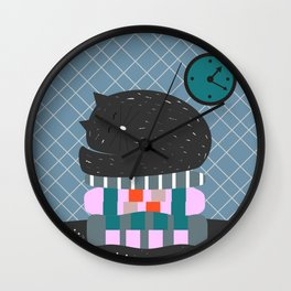 Cat sleeping on pillows Wall Clock