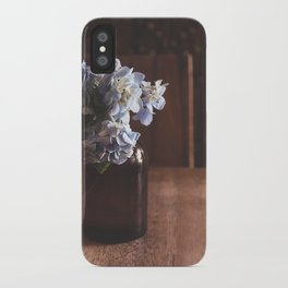Flowers on a table iPhone Case
