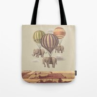 blue Tote Bags featuring Flight of the Elephants  by Terry Fan