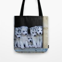 puppies Tote Bags featuring Husky puppies by Nathalie Photos