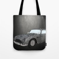 james bond Tote Bags featuring James Bond Aston Martin DB5 by Dany Delarbre