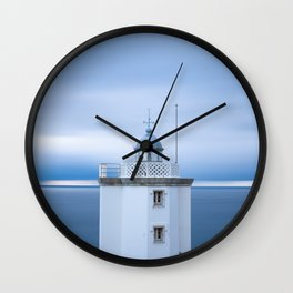Lighthouse at sunset with clouds in the sky Wall Clock