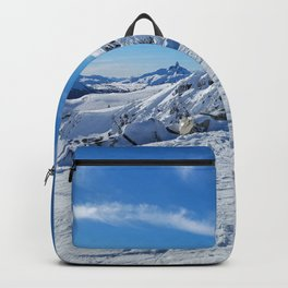 Play of light on mountains snow Backpack