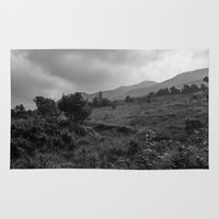 patrick Area & Throw Rugs featuring Croagh Patrick by Aaron Stapleton