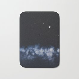 Contrail moon on a night sky Bath Mat