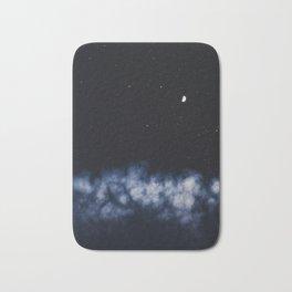 Contrail moon on a night sky Bath Mat