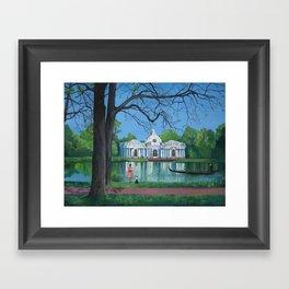 Girl in red dress walking the dog in the park. Framed Art Print