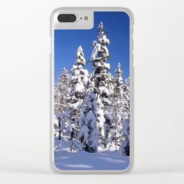 Snow covered trees in the forest. Winter day with blue sky. Clear iPhone Case