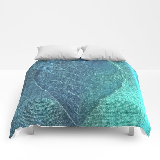 Light blue teal tonnes with an abstract leaf  Comforters