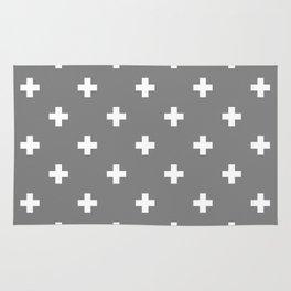 Swiss cross pattern on gray Rug