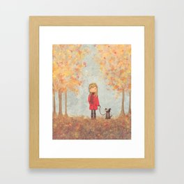 Little girl with dog in autumn landscape Framed Art Print
