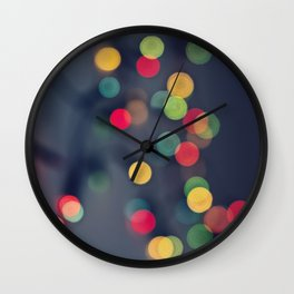 Blurred background with multicolored lights of garland Wall Clock