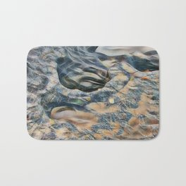 Abstract eroded rocks on beach with puddle Bath Mat