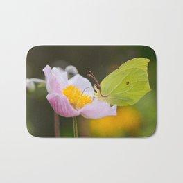 Yellow butterfly on a flower Bath Mat