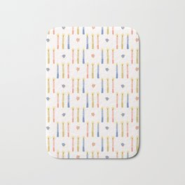 Hand drawn lit candles in blue, pink, yellow. Bath Mat