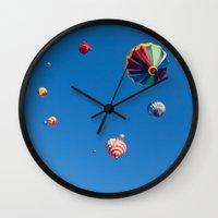 hot air balloons Wall Clocks featuring Vibrant Hot Air Balloons by Nicolas Raymond
