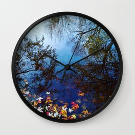 Trees reflected by water. Autumn, fall, maple leaves, blue Wall Clock