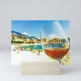 Glass of rose wine on the seacoast of the French Riviera Mini Art Print