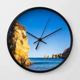 Turquoise waters and cliffs of Praia Dona Ana beach in Algarve, Portugal Wall Clock
