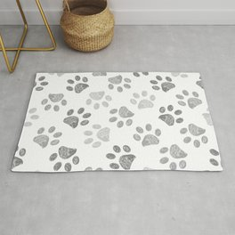 Black and grey paw print pattern Rug