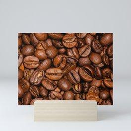 Shiny brown coffee beans Mini Art Print