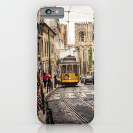 Tram 28 transports tourists through Alfama district in Lisbon, Portugal iPhone Case