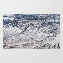 Aerial shot of winter snow mountain Rug