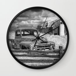 Black and White of Rusted International Harvester Pickup Truck behind wooden fence with Red Barn in Wall Clock