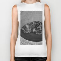 sofa Biker Tanks featuring sleeping cat on sofa by gzm_guvenc