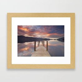 Flooded jetty in Derwent Water, Lake District, England at sunset Framed Art Print