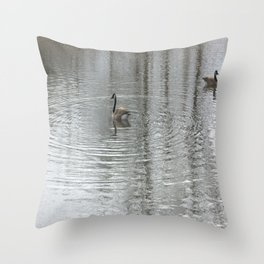 Geese swimming Throw Pillow