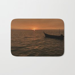 Sunset view with small boat, sampan at the seaside Bath Mat