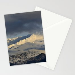 Snowy mountains through the clouds. Stationery Cards