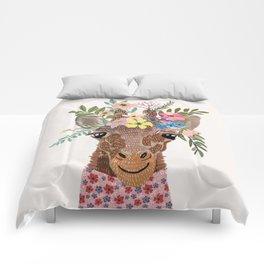 Giraffe with flowers on head Comforters
