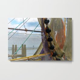 Fishing nets hanging on a boat. Metal Print