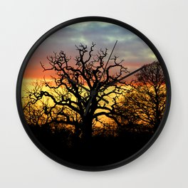 Winter sunset behind a curly tree Wall Clock