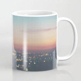 Looking down on the lights of Los Angeles as night. Coffee Mug