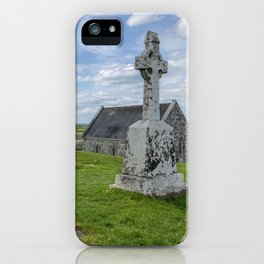 View of cemetery at the Clonmacnoise historic monastery ruins in County Offaly, Ireland iPhone Case