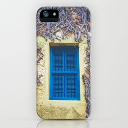 blue shutter window in yellow building with creeping vines iPhone Case