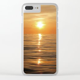Sun setting over calm waters Clear iPhone Case