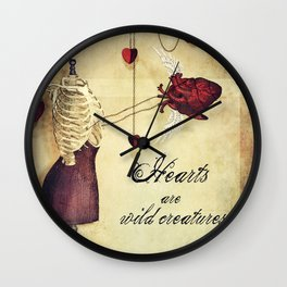 hearts are wild creatures Wall Clock