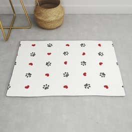 Doodle black paw print with red hearts seamless fabric design repeated pattern Rug